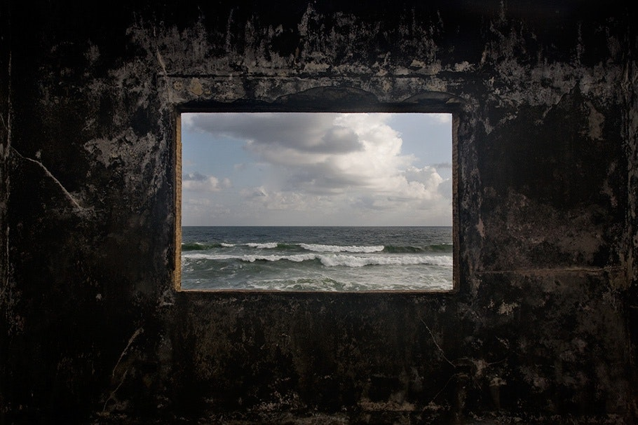 Ocean seen through window.