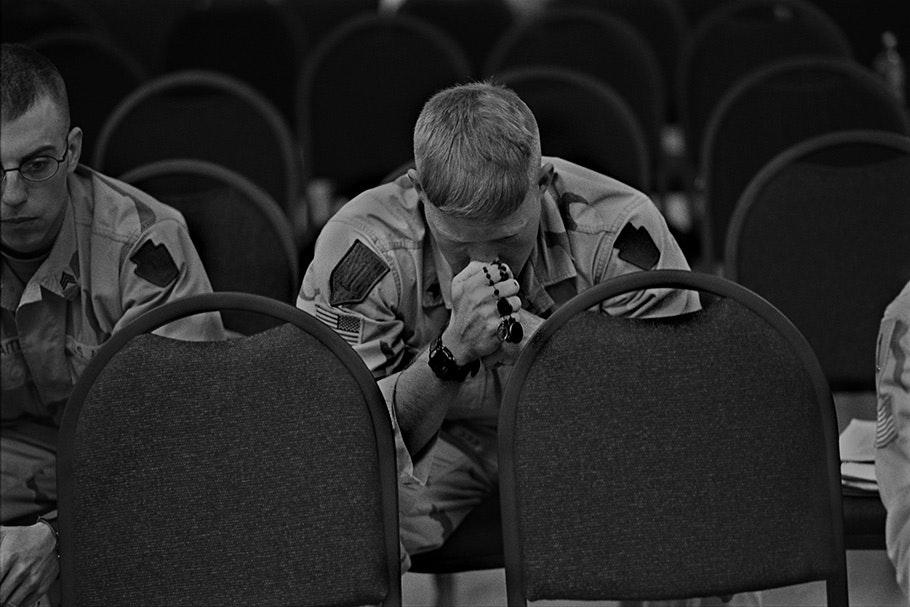 Soldier praying.