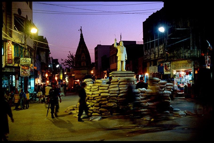 Night street scene with statue.