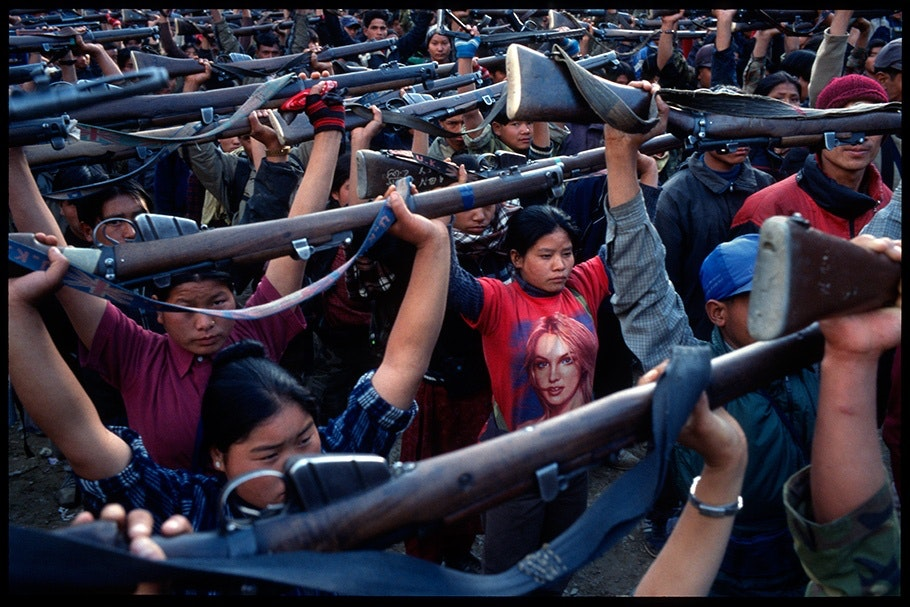 Group holding guns over their heads.