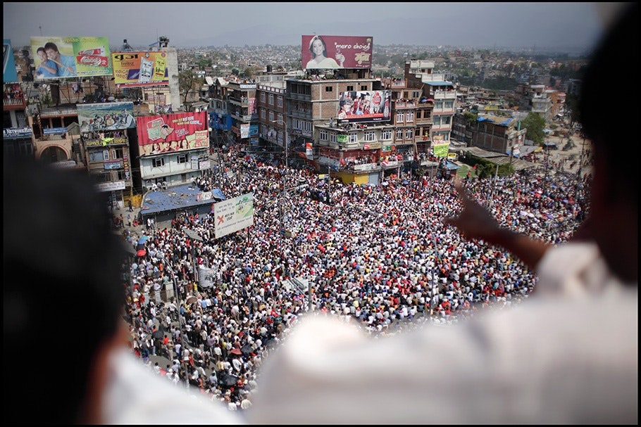 View from above of crowd on street.