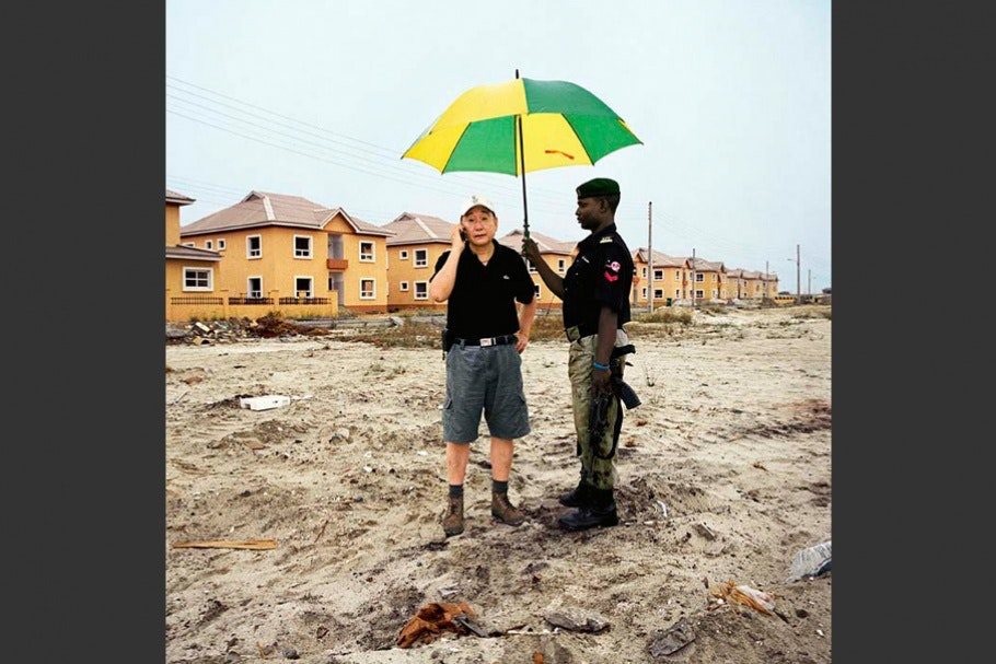 Two men with umbrella.