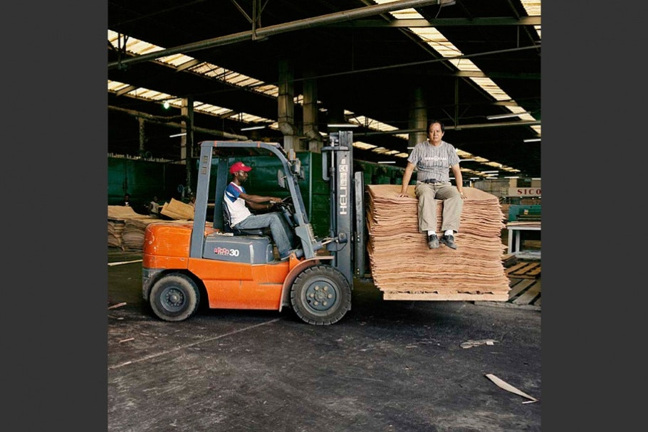 Two men with forklift.