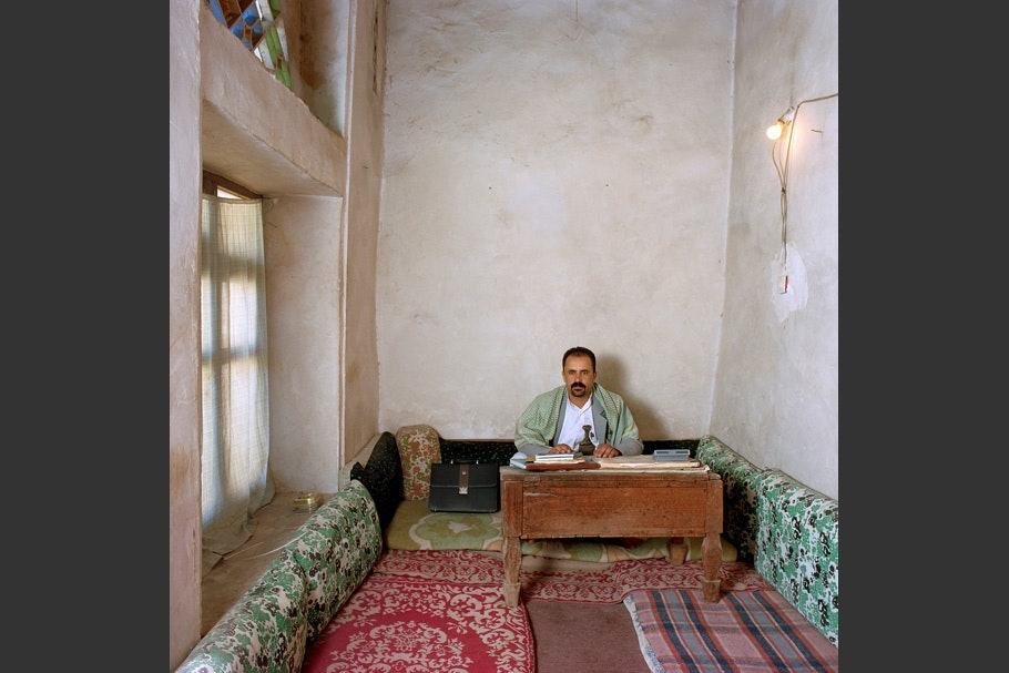 Narrow office with carpets.