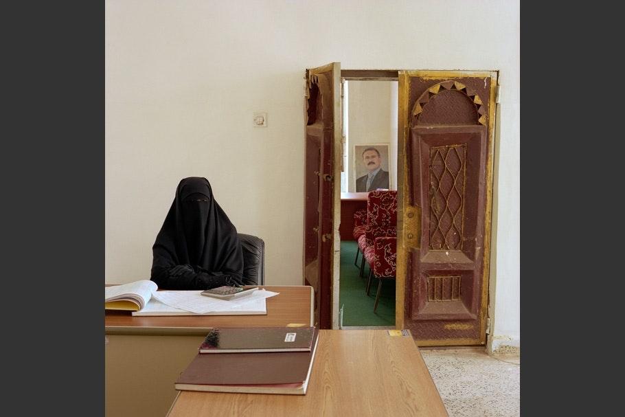 Woman in burqa.