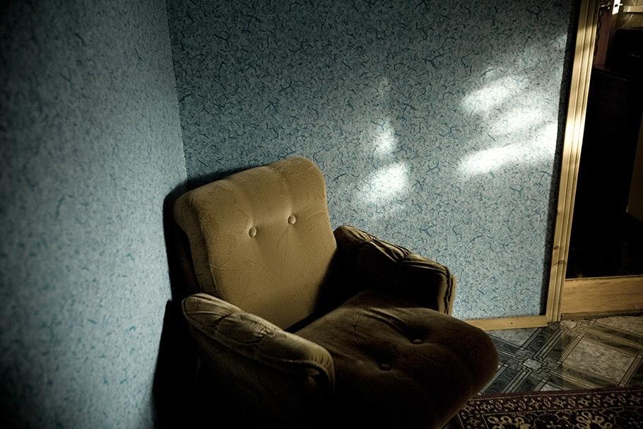 Empty brown armchair.