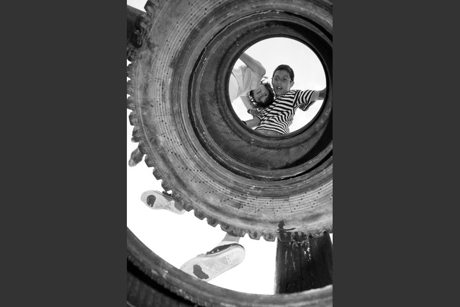 Children viewed through tire.