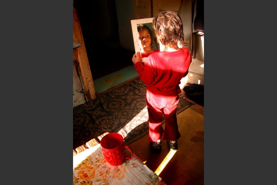 Woman in red looking at mirror
