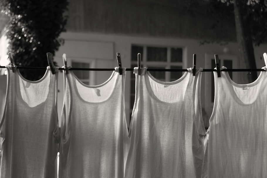 Shirts hanging on laundry line.