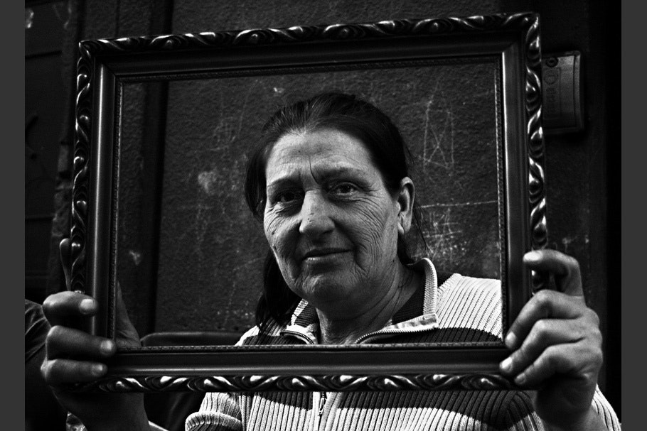 Woman viewed through picture frame.