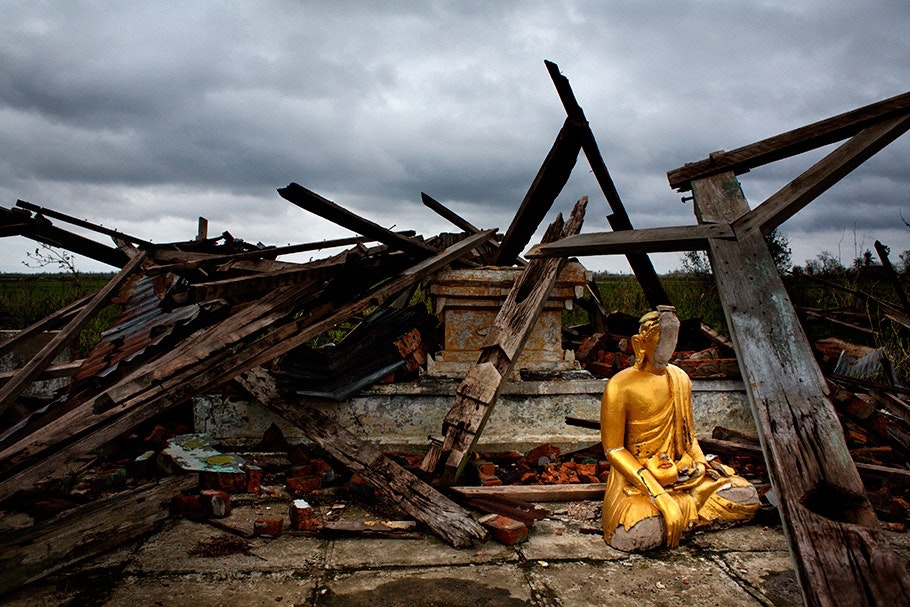 Buddha amidst rubble.