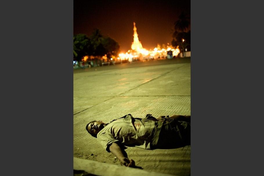 Man lying in street.