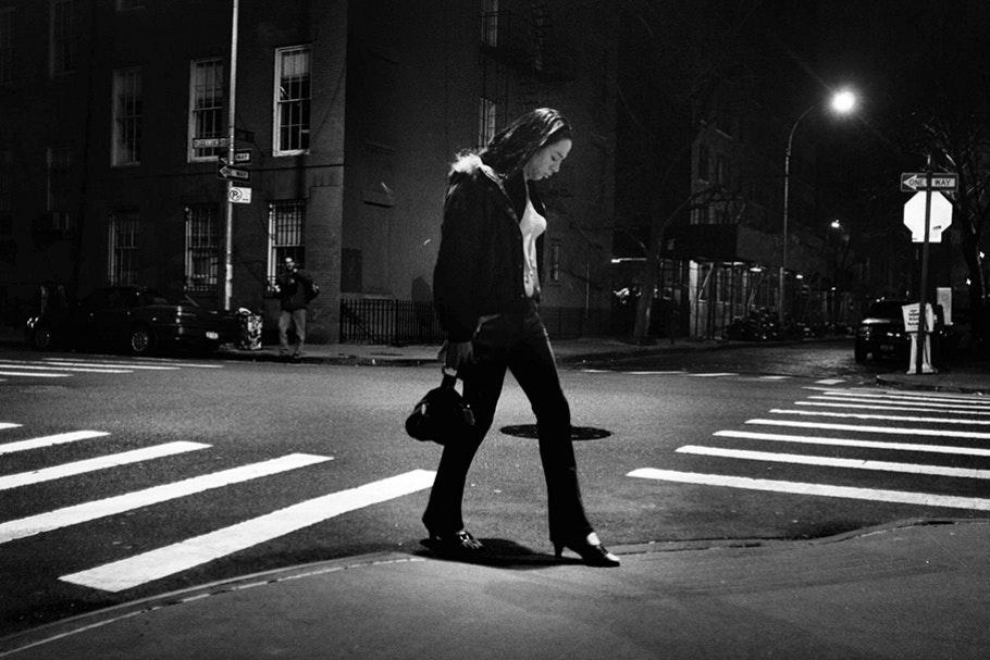 Walking in crosswalk.
