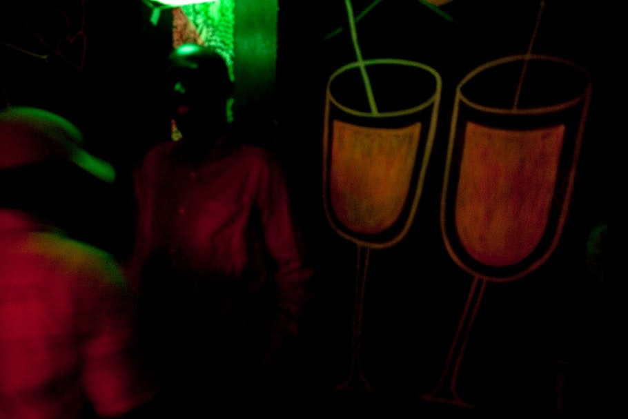Bar scene with painted drinks.
