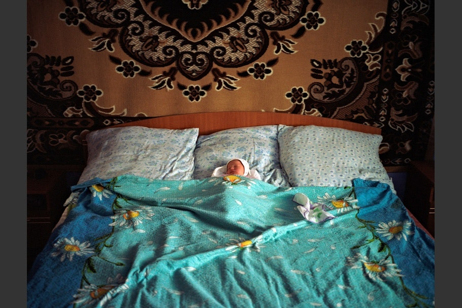 Baby in bed.