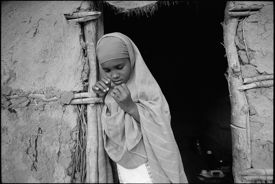 Girl in a doorway.