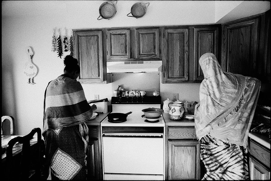Two women in a kitchen.