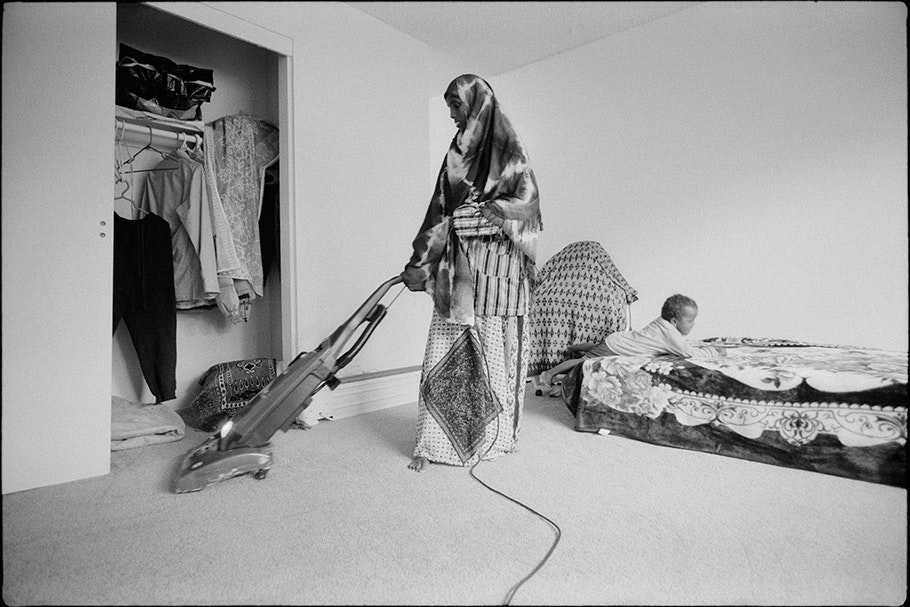 Woman using a vacuum cleaner.
