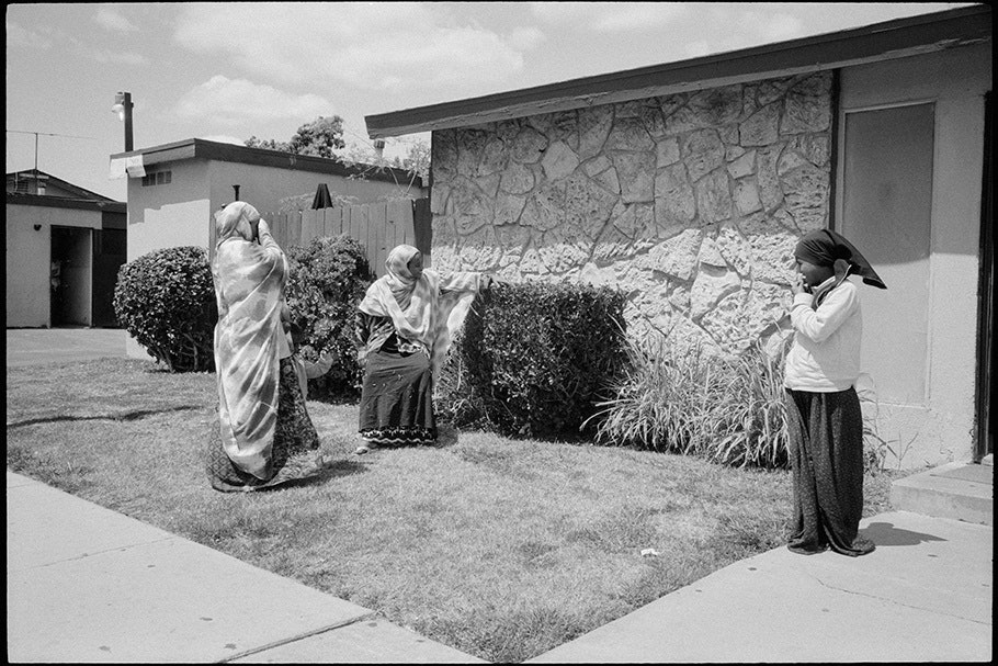Three women outside of a home.