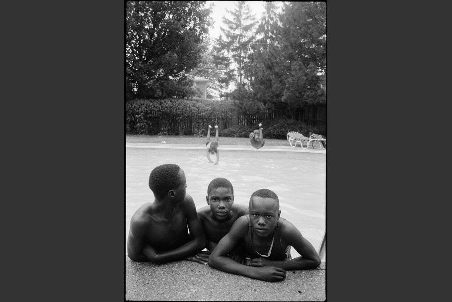 Teenage boys in a pool.