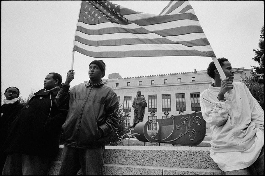 Demonstrators with flag.