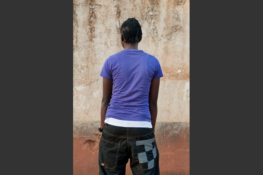 Purple t-shirt with jeans with checkered back pocket.