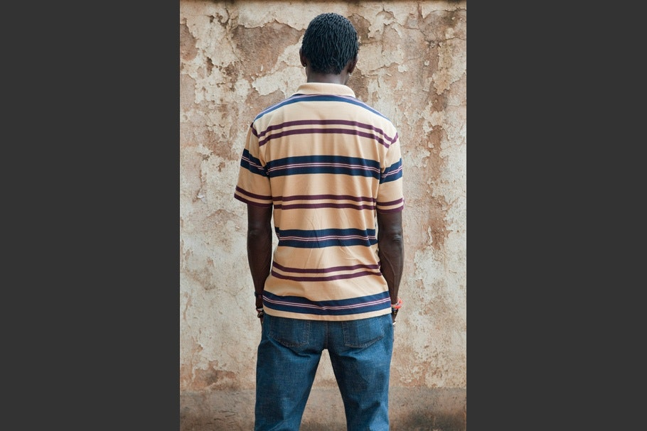 Striped shortsleeved shirt with jeans.