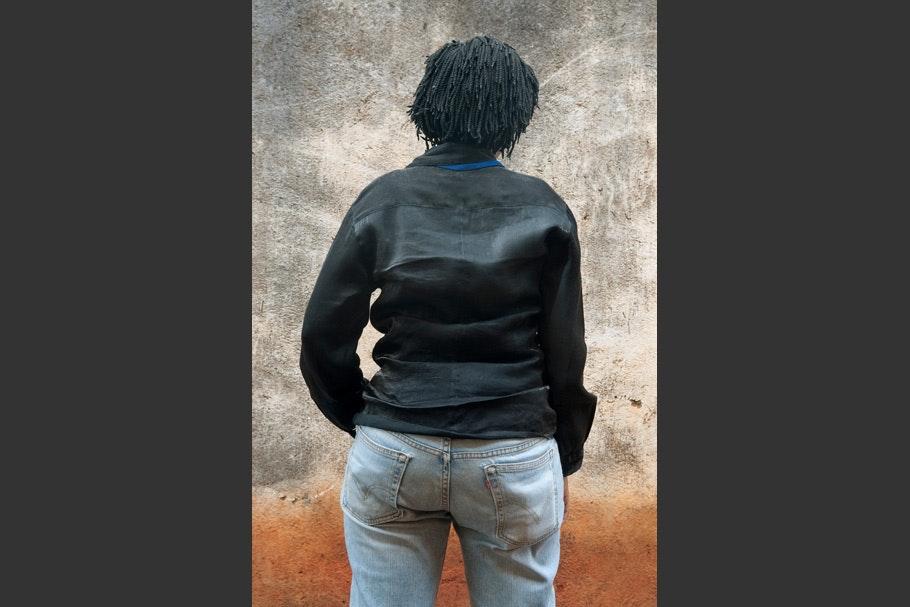 Black jacket, light jeans.
