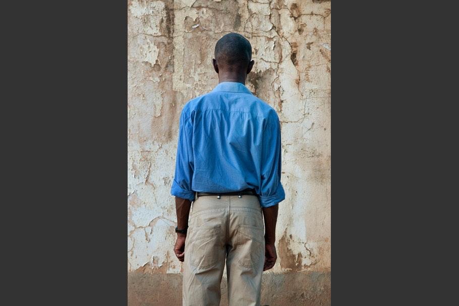 Bright blue long-sleeved shirt, khakis.