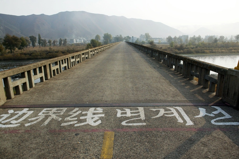 An entrance to a bridge that separates China from North Korea.