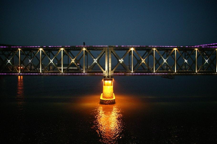 A truck passes the Sino-Korean Friendship Bridge.