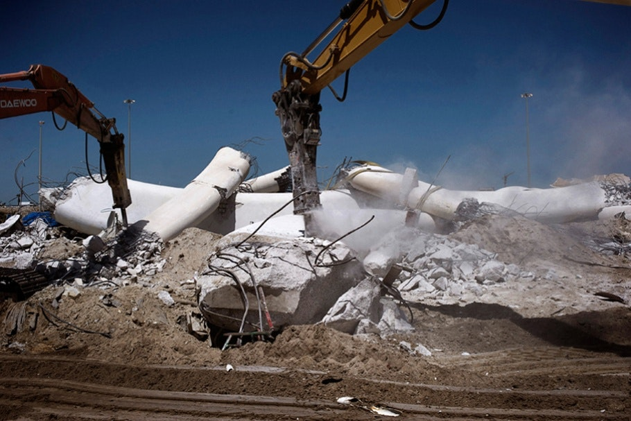 Machinery destroying a monument.