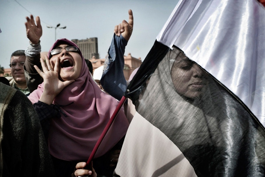 A woman shouts during a rally.