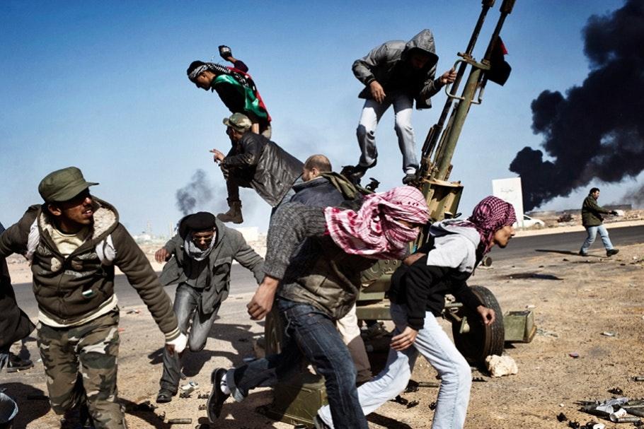 Rebels fleeing gunfire.