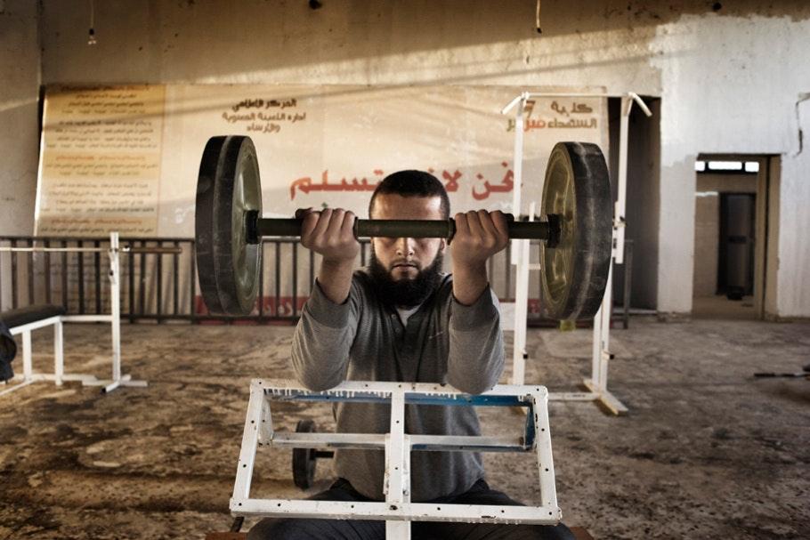 A man lifting a weight.
