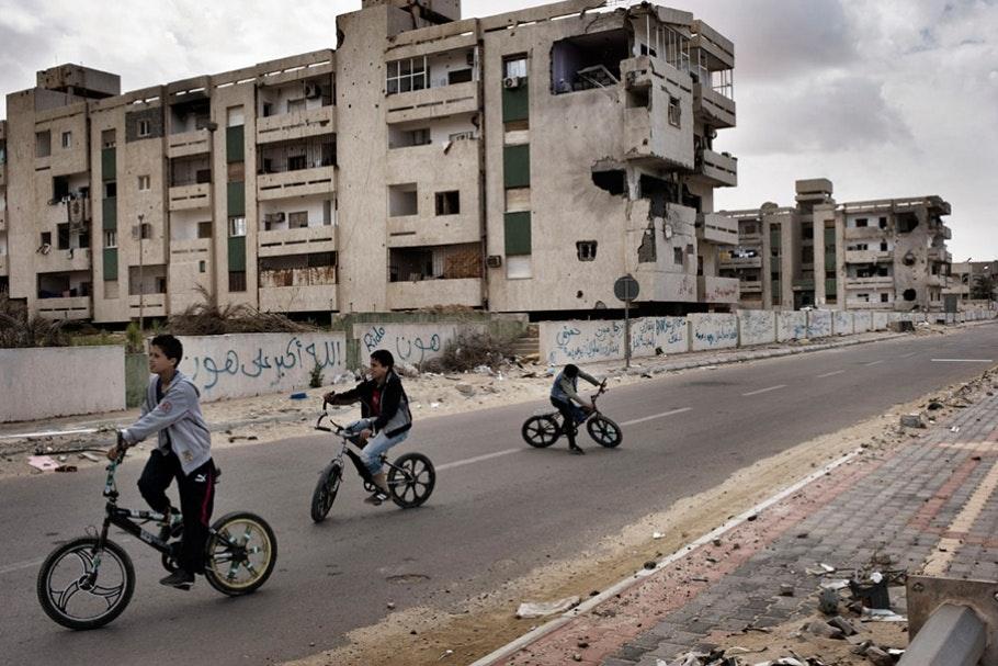 Children riding bikes on a street.