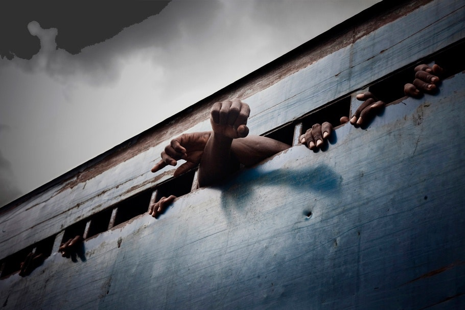 Incarcerated men in a truck.