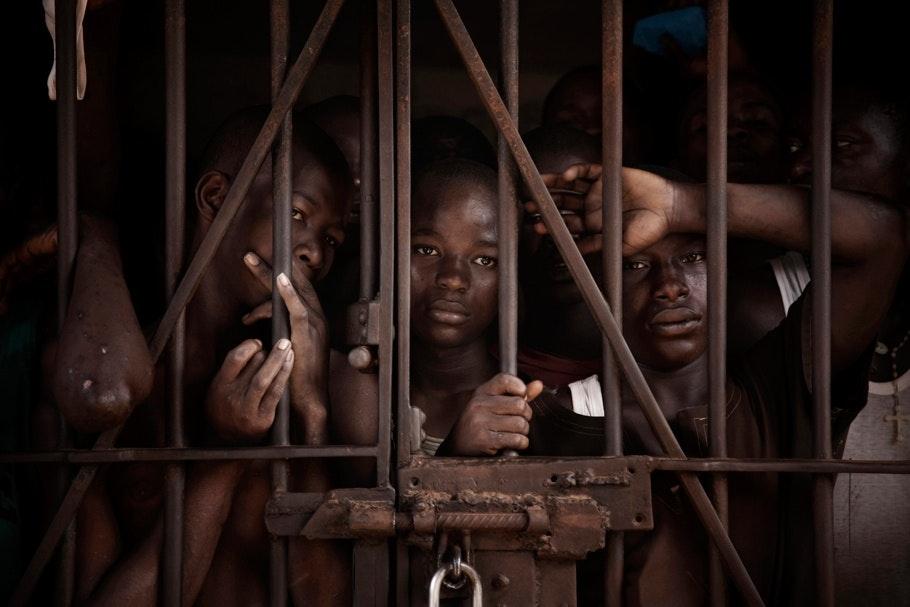 Boys behind bars.
