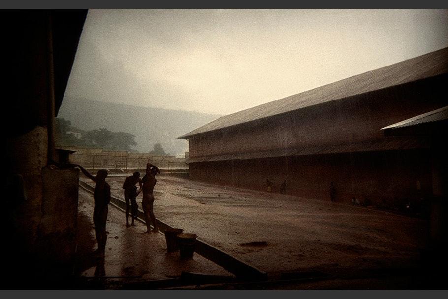 Men bathing outside in the rain.