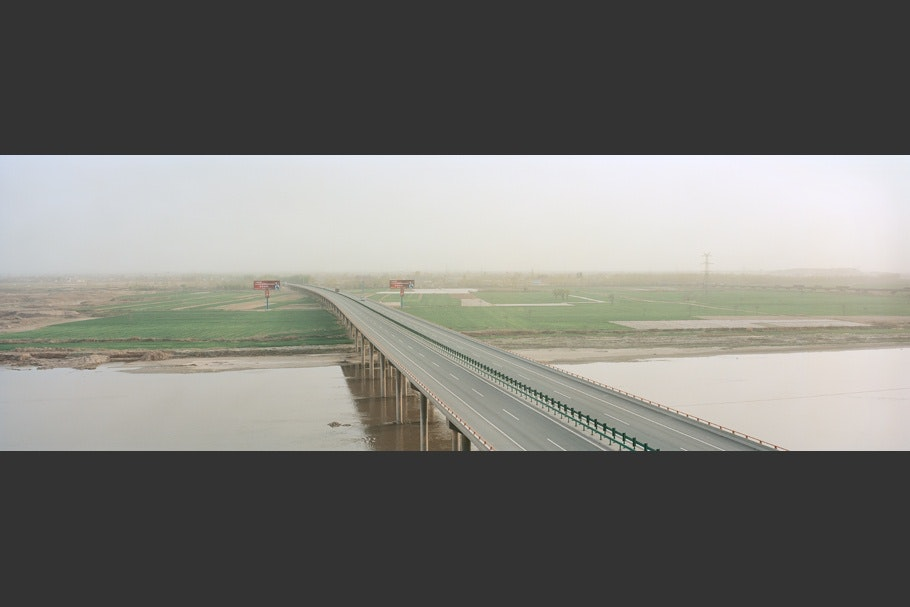 A long bridge over a river.