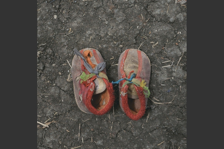 A pair of worn of children shoes