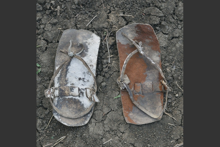 A pair of worn leather sandals