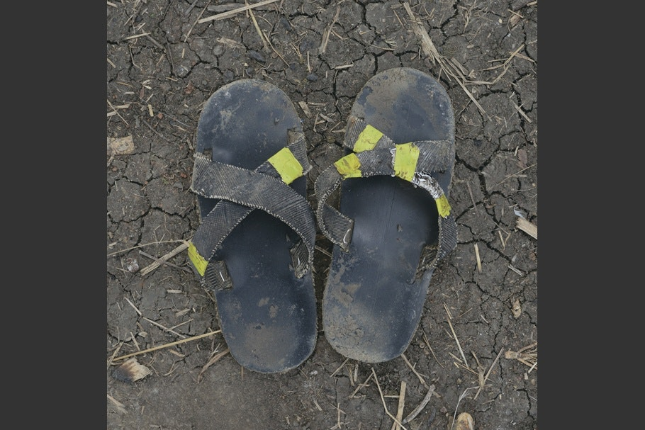 A pair of worn sandals