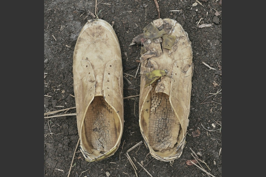 A pair of worn sneakers