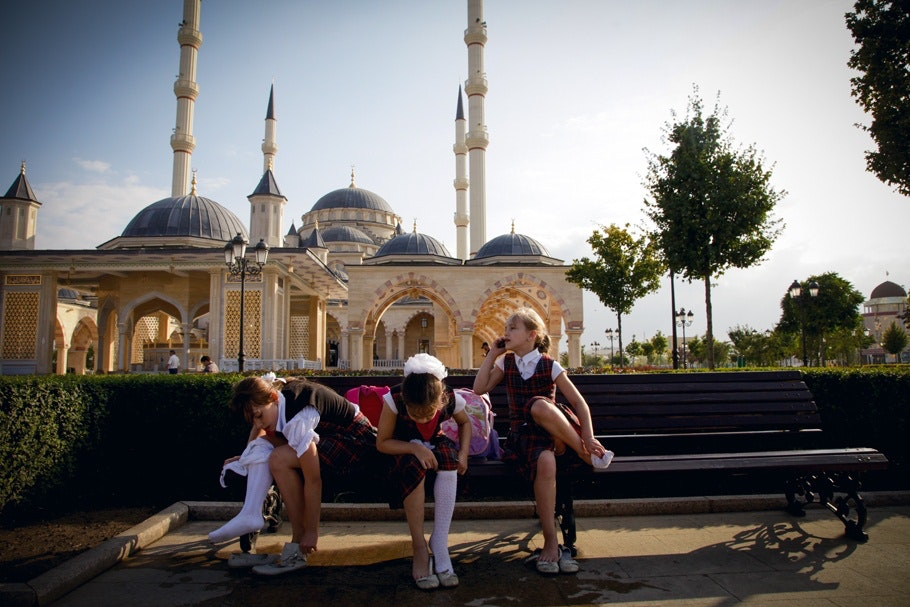 School girls sitting on a bench