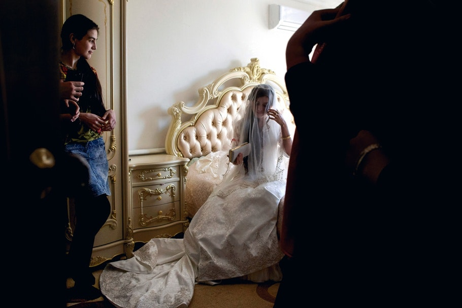A bride sitting on a bed