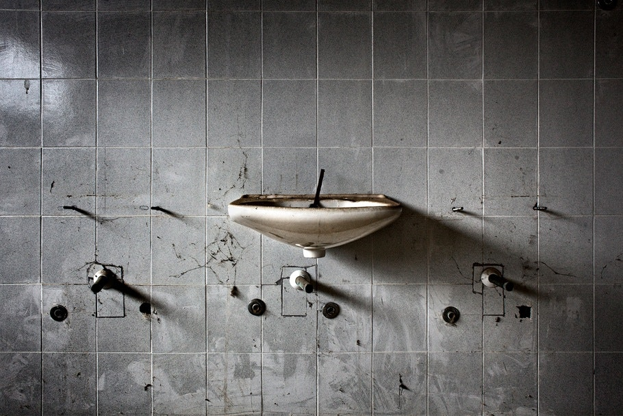 Tiled wall with sink.
