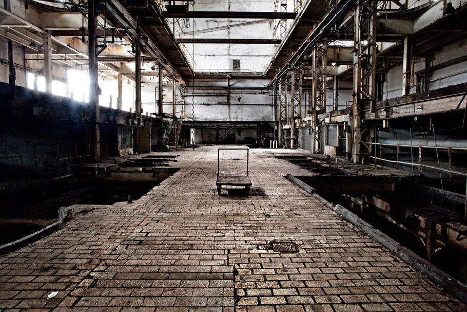 A dolly inside an abandoned factory.