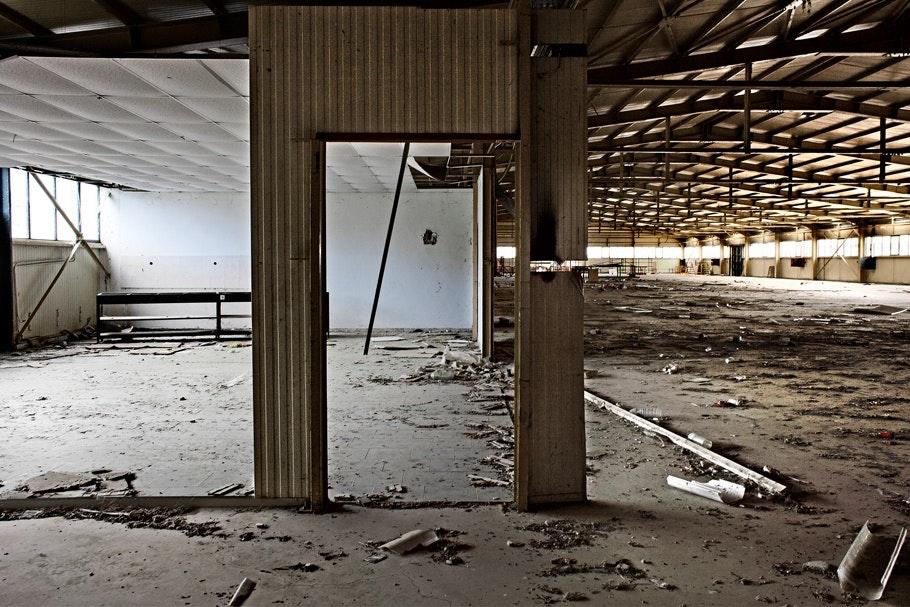 Doorframe inside an abandoned factory.