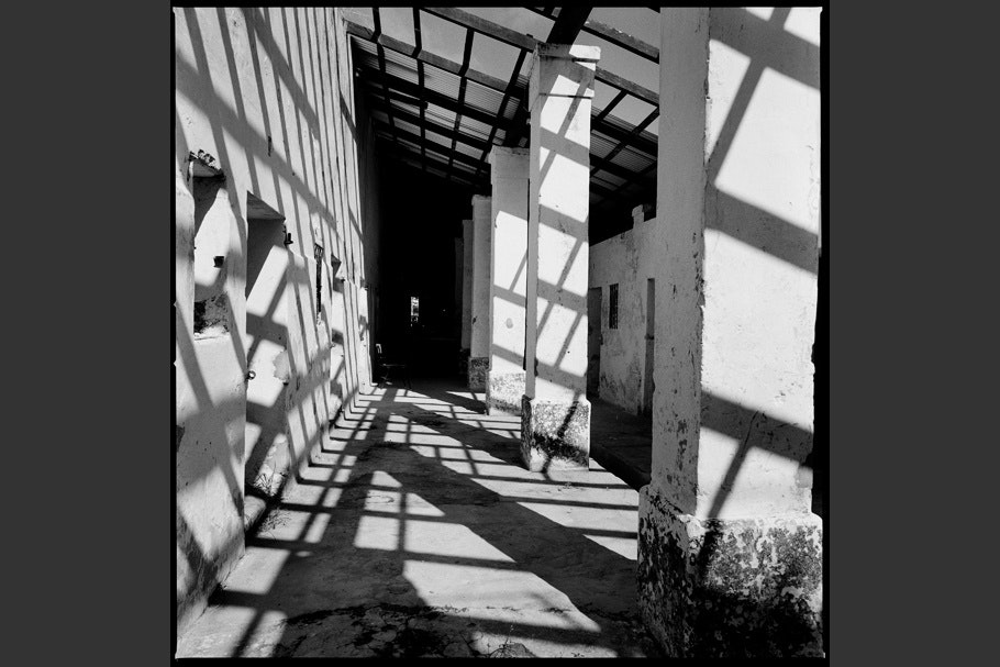 Shadows cast across a walkway of a former concentration camp